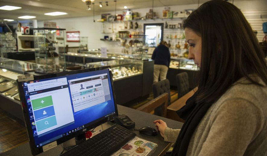 In this Wednesday, Nov. 23, 2016, file photo, Ashley Nicklaus, owner of the Pawn and Jewelry Exchange explains the Precious Metals Database, and how she uses that system and her personal jewelry tracking system by Bravo, to keep track of items coming into her pawn shop in Greensburg, Pa. (Dan Speicher/Pittsburgh Tribune-Review via AP) ** FILE **