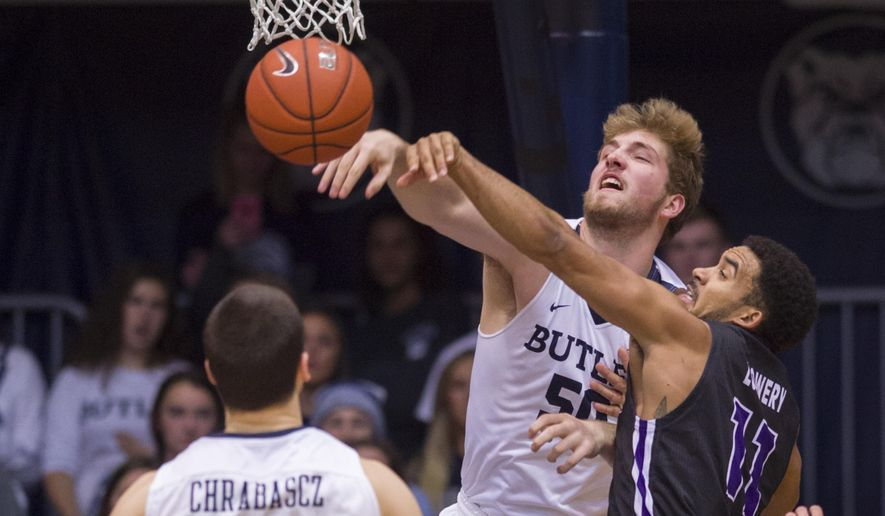 Central Arkansas guard Jeff Lowery (11), right, and Butler forward Joey Brunk (50) battle for a rebound in the second half of an NCAA college basketball game in Indianapolis, Saturday, Dec. 3, 2016. (AP Photo/Doug McSchooler)