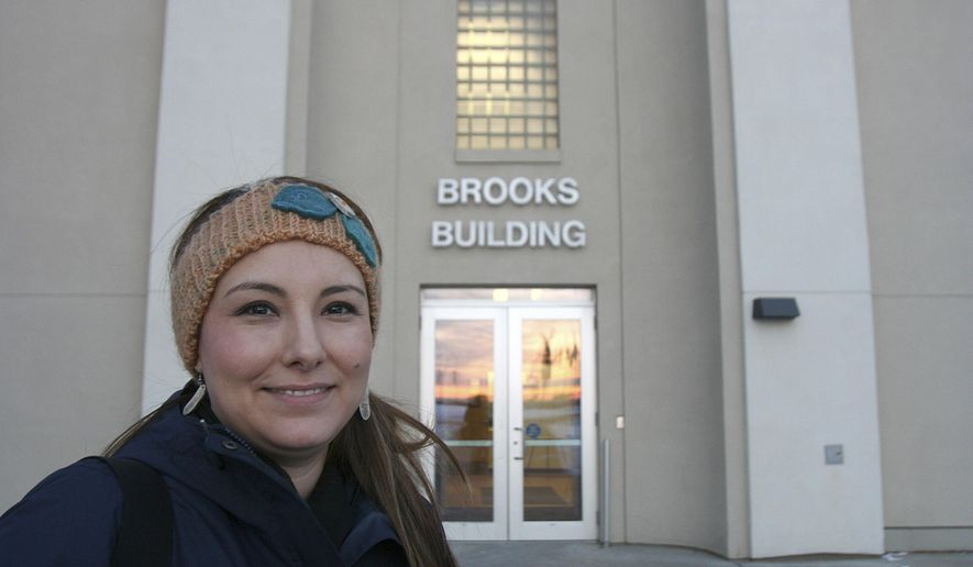 ADVANCE FOR USE SATURDAY, DEC. 3 - In this Nov. 23, 2016 photo, Charlene Stern poses outside of the Brooks Building at the University of Alaska, Fairbanks, where she teaches community planning and development in Fairbanks, Alaska. After spending years outside studying community planning and development, Stern returned to Alaska to fulfill her goal of helping Native communities. (Kevin Baird/Fairbanks Daily News-Miner via AP)
