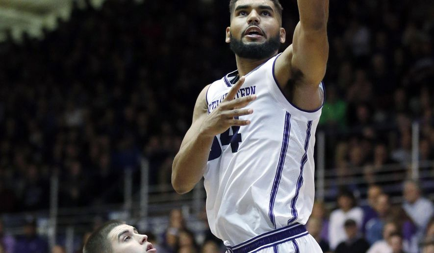 Northwestern's Sanjay Lumpkin, right, drives to the basket against DePaul guard Chris Harrison-Docks during the first half of an NCAA college basketball game Saturday, Dec. 3, 2016, in Evanston, Ill. (AP Photo/Nam Y. Huh)