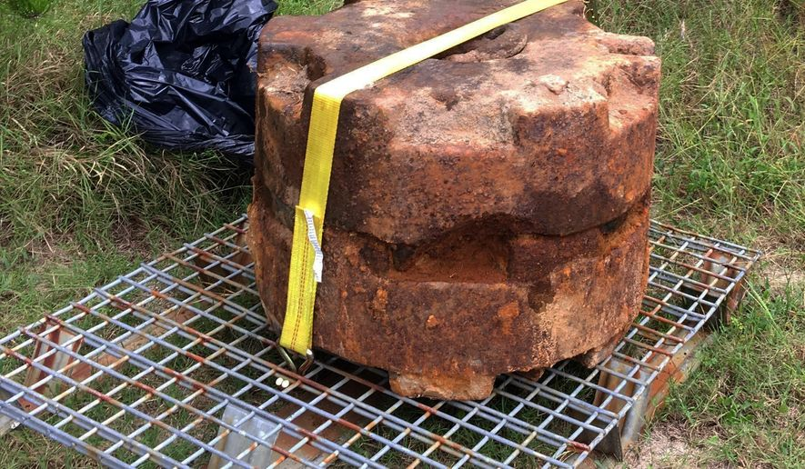 Two mine weights from WWII were recently discovered in a pathway to the beach at Cape Henlopen State Park. The weights were exposed during Hurricane Hermine, and are relics from Cape Henlopen's role as Fort Miles, part of the Army's coastal defense network during WWII.  (Molly Murray/The News Journal via AP)