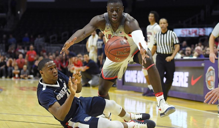 Gonzaga guard Jordan Mathews, left, tries to pass from the floor as Arizona guard Rawle Alkins steals it during the first half of an NCAA college basketball game, Saturday, Dec. 3, 2016, in Los Angeles. (AP Photo/Mark J. Terrill)