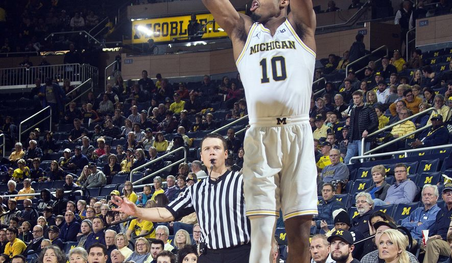 Michigan guard Derrick Walton Jr. (10) shoots a 3-point basket in the second half of an NCAA college basketball game against Kennesaw State at Crisler Center in Ann Arbor, Mich., Saturday, Dec. 3, 2016. (AP Photo/Tony Ding)