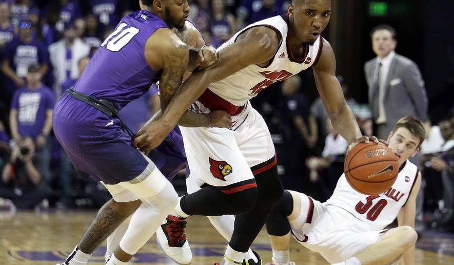 Louisville guard Donovan Mitchell steals the ball from Grand Canyon guard Shaq Carr (10) during the first half of an NCAA college basketball game, Saturday, Dec. 3, 2016, in Phoenix. (AP Photo/Rick Scuteri)