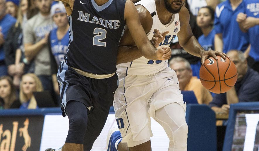 Duke's Matt Jones, right, handles the ball as Maine's Ryan Bernstein (3) defends during the first half of an NCAA college basketball game in Durham, N.C., Saturday, Dec. 3, 2016. (AP Photo/Ben McKeown)