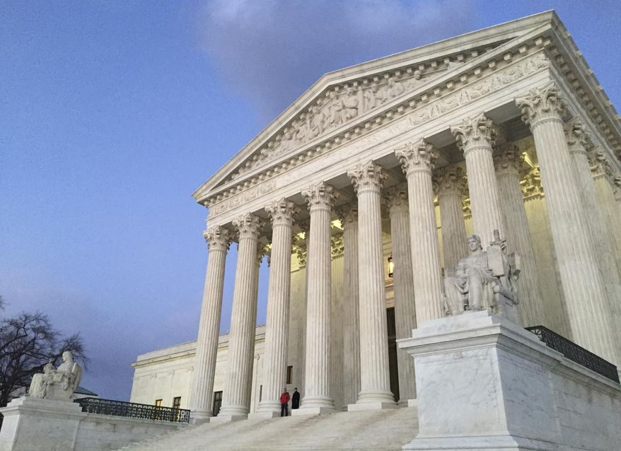 People stand on the steps of the Supreme Court at sunset in this Feb. 13, 2016, file photo. (AP Photo/Jon Elswick, file)