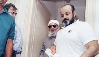 Emad Salem, 43, the confidential informant in an alleged bombing plot, June 17, 1993 in Jersey City, N.J. Escorting blind Muslim clericSheik Omar Abdul-Rahman at a news conference at the Sheik' s apartment In Jersey City . (AP Photo/Daniel Hulshizer)