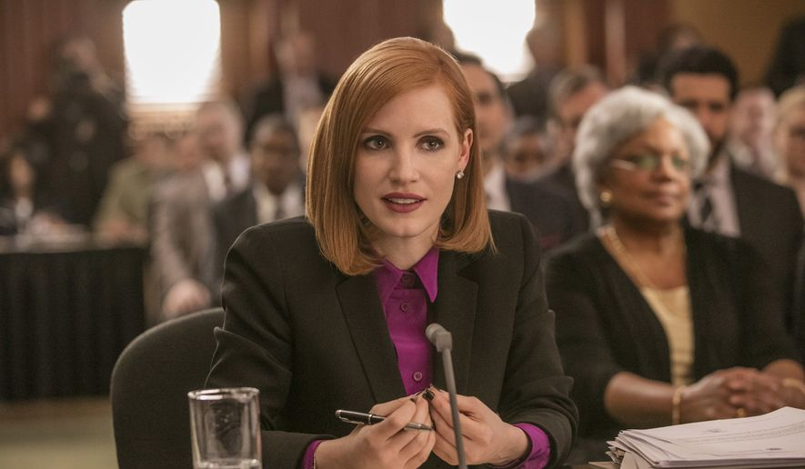 "This image released by Europa shows Jessica Chastain in a scene from, ""Miss Sloane.""  (Kerry Hayes/Europa via AP)"