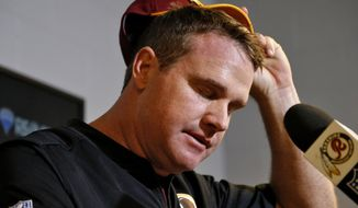 Washington Redskins head coach Jay Gruden speaks after an NFL football game against the Arizona Cardinals, Sunday, Dec. 4, 2016, in Glendale, Ariz. The Cardinals won 31-23. (AP Photo/Ross D. Franklin) **FILE**