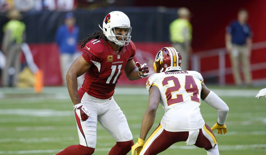 Arizona Cardinals wide receiver Larry Fitzgerald (11) lines up against Washington Redskins cornerback Josh Norman (24) during the first half of an NFL football game, Sunday, Dec. 4, 2016, in Glendale, Ariz. (AP Photo/Ross D. Franklin)