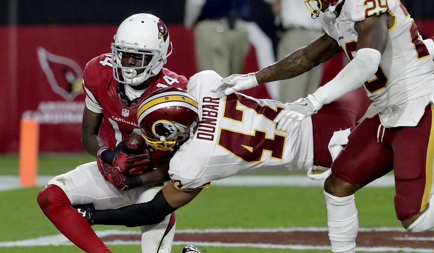 Arizona Cardinals wide receiver J.J. Nelson (14) makes a touchdown catch as Washington Redskins cornerback Quinton Dunbar (47) defends during the second half of an NFL football game, Sunday, Dec. 4, 2016, in Glendale, Ariz. (AP Photo/Rick Scuteri)