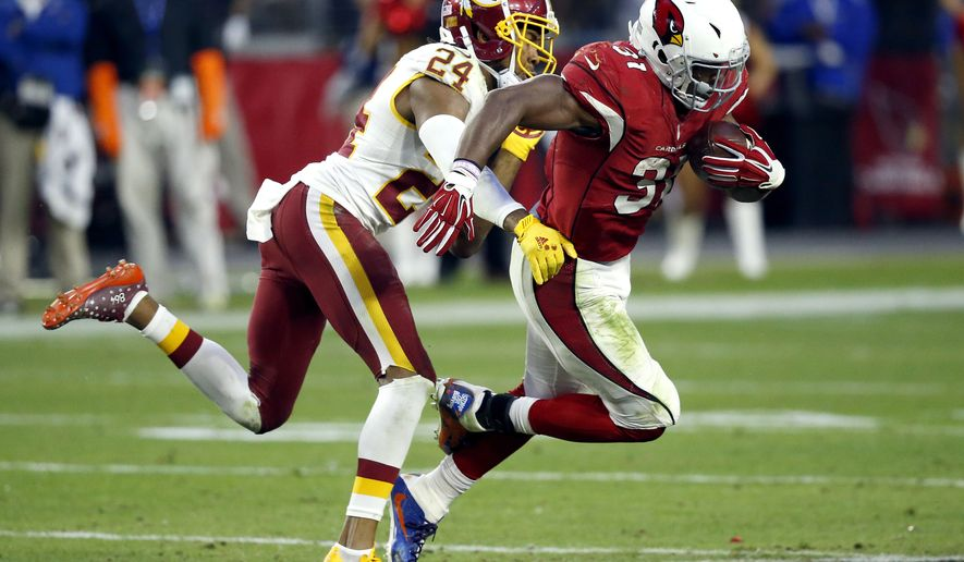 Arizona Cardinals running back David Johnson (31) is hit by Washington Redskins cornerback Josh Norman (24) during the second half of an NFL football game, Sunday, Dec. 4, 2016, in Glendale, Ariz. (AP Photo/Ross D. Franklin)
