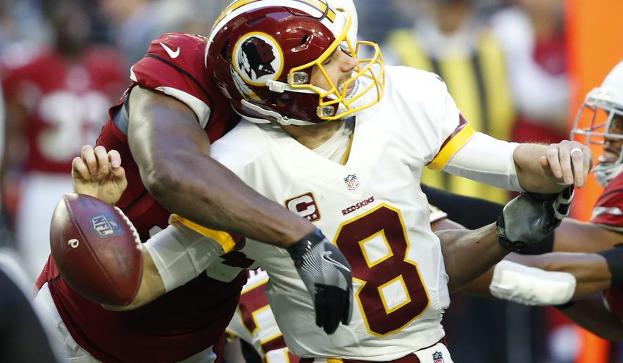Arizona Cardinals defensive end Calais Campbell forces Washington Redskins quarterback Kirk Cousins (8) to fumble during the second half of an NFL football game, Sunday, Dec. 4, 2016, in Glendale, Ariz. The Cardinals recovered the ball on the play. (AP Photo/Ross D. Franklin)