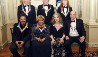 The 2016 Kennedy Center Honorees, front row, from left, Al Pacino, Mavis Staples, Martha Argerich and James Taylor, back row, from left, Joe Walsh, Don Henley and Timothy Schmit are photographed at the State Department for the Kennedy Center Honors gala dinner, Saturday, Dec. 3, 2016, in Washington. (AP Photo/Kevin Wolf)