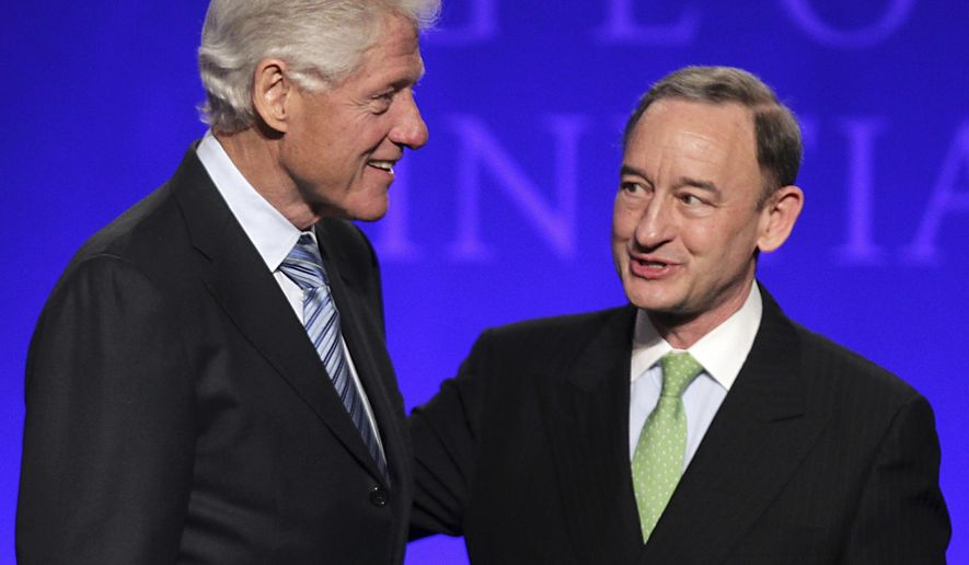 FILE - In this Friday, April 5, 2013, file photo, former President Bill Clinton, left, greets Mark S. Wrighton, chancellor of Washington University, during the opening session of the Clinton Global Initiative at Washington University in St. Louis. In a new study released Sunday, Dec. 4, 2016, by the Chronicle of Higher Education, eight private colleges paid their presidents more than $2 million in 2014, the most ever to hit that mark. Wrighton, who was paid $4.2 million in 2014, ranks second on the list. (Robert Cohen/St. Louis Post-Dispatch via AP, File)