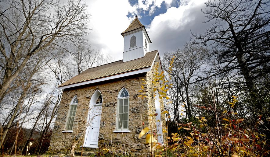 "This Nov. 18, 2016 photo shows the Pine Chapel in Dubuque, Iowa. Work recently wrapped up on the restoration of the chapel. The project was supported by a $17,000 fundraising effort by Friends of the Mines of Spain. The effort was led by Gerda Preston Hartman, who said she views the chapel as a ""spiritual place."" (Dave Kettering/Telegraph Herald via AP)"