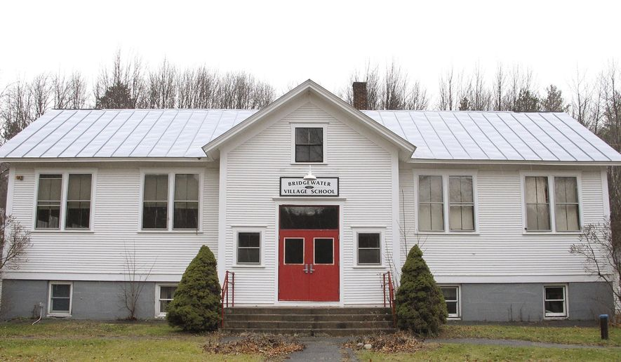 This Dec. 2, 2016 photo shows the former Bridgewater Village School in Bridgewater, Vt. The town has voted to tear down the 100-year-old building because the costs to maintain it are too high. Last year the town voted to close the school and send the students to a consolidated school in neighboring Pomfret. (AP Photo/Lisa Rathke)