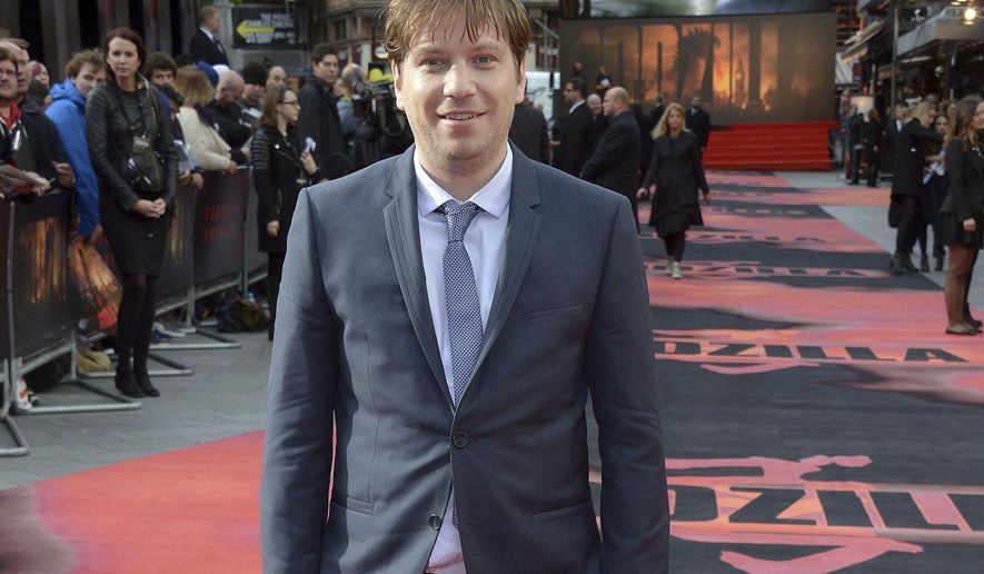 """FILE - In this May 11, 2014 file photo, director Gareth Edwards poses for photographers on the red carpet for the UK premiere of Godzilla in London. Edwards says he gave himself a cameo in the """"Star Wars"""" spinoff """"Rogue One: A Star Wars Story."""" Arriving in theaters on Dec. 16, 2016, """"Rogue One"""" is the first in a series of spinoffs set inside the universe of """"Star Wars."""" (Photo by Jon Furniss/Invision/AP, File)"""