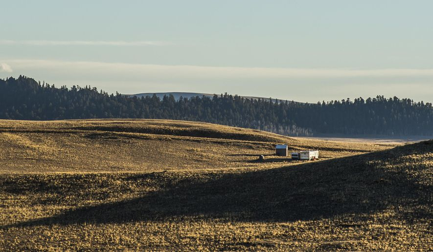 This Nov. 10, 2016 photo shows trailers in the Hartsel Springs Ranches area near Hartsel, Colo. A wave of recent settlers have transformed the outskirts of this gritty mountain outpost 65 miles west of Colorado Springs. RVs, Tuff Sheds and nylon tents where they live without electricity or running water have come to dominate the mountain-capped vistas that surround the unincorporated area.  (Stacie Scott/The Gazette via AP)