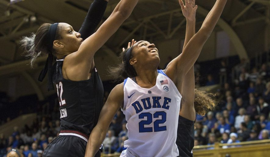 Duke's Oderah Chidom (22) attempts a basket as South Carolina's A'ja Wilson (22) defends during the first half of an NCAA college basketball game in Durham, N.C., Sunday, Dec. 4, 2016. (AP Photo/Ben McKeown)
