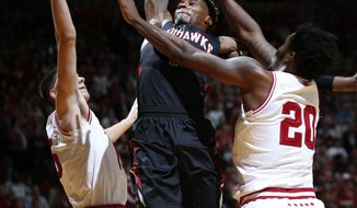 Southeast Missouri guard Antonius Cleveland, center, dunks between Indiana defenders Zach McRoberts, left, and De'Ron Davis in the first half of an NCAA college basketball game in Bloomington, Ind., Sunday, Dec. 4, 2016. (AP Photo/AJ Mast)