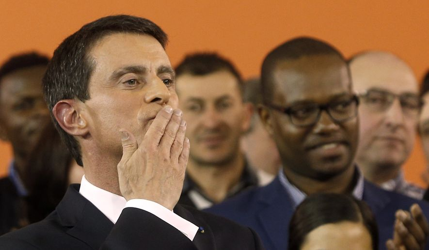 French Prime Minister Manuel Valls blows a kiss to the audience after announcing his candidacy for the Socialist primary next month, in Evry, outside Paris, Monday Dec. 5, 2016. Valls hopes to unite the Socialists under his banner and give the left a chance to stay at the Elysee, in the most ambitious challenge of his political life after president Francois Hollande decided not to run for re-election next year. (AP Photo/Thibault Camus)