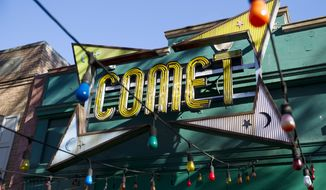 """The front door of Comet Ping Pong pizza shop, in Washington, Monday, Dec. 5, 2016. A fake news story prompted a man to fire a rifle inside a popular Washington, D.C., pizza place as he attempted to """"self-investigate"""" a conspiracy theory that Hillary Clinton was running a child sex ring from there, police said.  ( AP Photo/Jose Luis Magana)"""