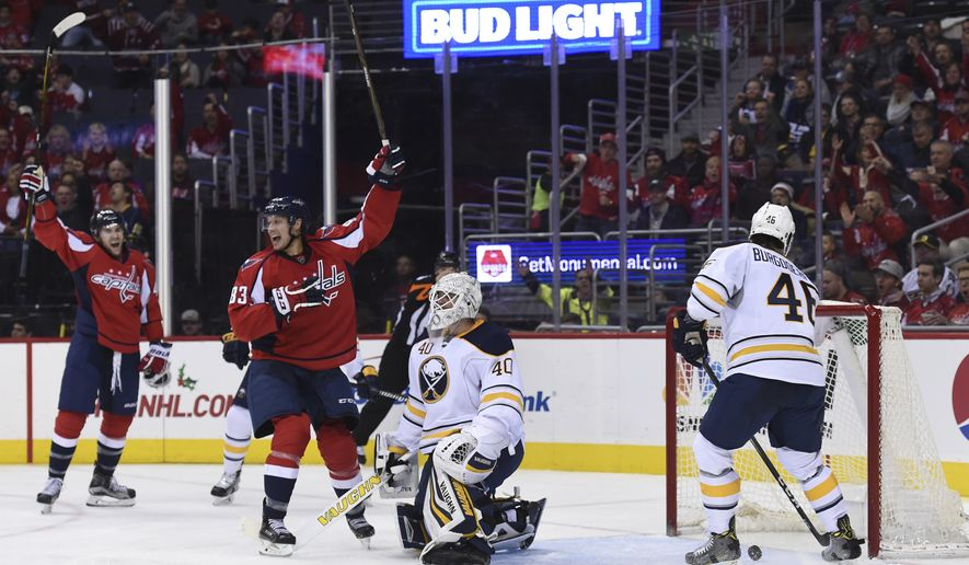 Washington Capitals right wing Jay Beagle (83) celebrates his goal agains Buffalo Sabres Robin Lehner (40), of Sweden, and Buffalo Sabres right wing Erik Burgdoerfer (46) during the second period of an NHL hockey game, Monday, Dec. 5, 2016, in Washington. (AP Photo/Molly Riley)