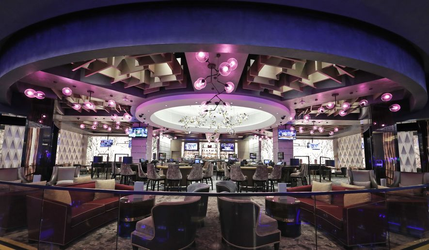 "The ""Blossom"" cocktail lounge is seen with a cherry blossom theme, during a preview tour of the MGM National Harbor, Friday, Dec. 2, 2016, in Oxon Hill, Md. (AP Photo/Alex Brandon) ** FILE **"