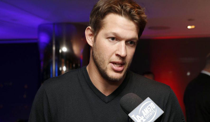 Los Angeles Dodgers' Clayton Kershaw talks with reporters during an Under Armour announcement event at Major League Baseball's winter meetings, Monday, Dec. 5, 2016 in Oxon Hill, Md. Under Armour will take over as the supplier of Major League Baseball uniforms in 2020. (AP Photo/Alex Brandon)
