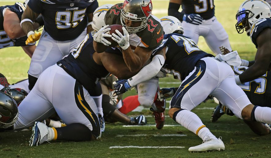 Tampa Bay Buccaneers running back Doug Martin (22) scores during the first half of an NFL football game against the San Diego Chargers, Sunday, Dec. 4, 2016, in San Diego. (AP Photo/Denis Poroy)