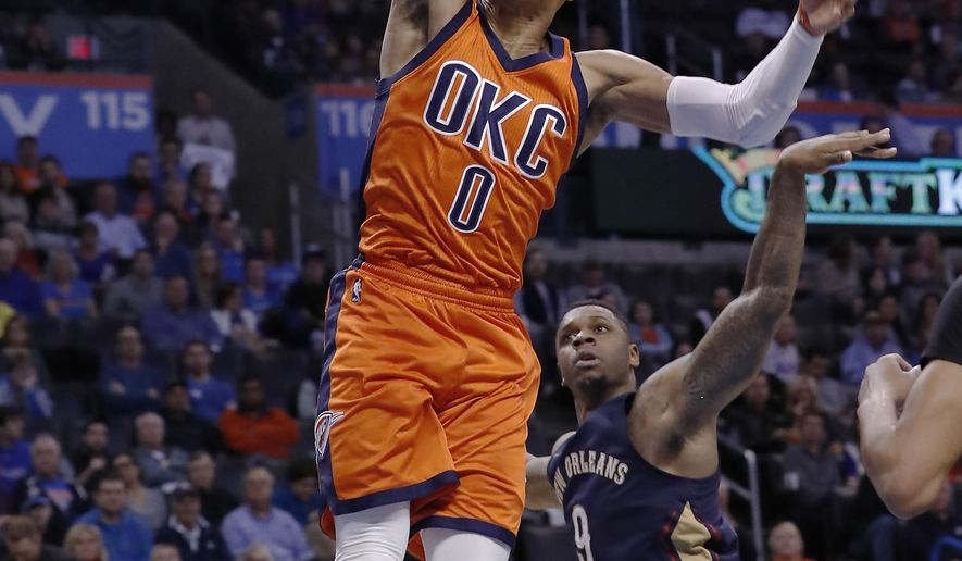 Oklahoma City Thunder guard Russell Westbrook (0) dunks ahead of New Orleans Pelicans forward Terrence Jones (9) during the second half of an NBA basketball game in Oklahoma City, Sunday, Dec. 4, 2016. Oklahoma City won 101-92. (AP Photo/Alonzo Adams)