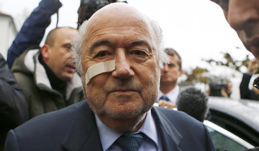FILE - In this Dec. 21, 2015 file photo, FIFA President Sepp Blatter arrives for a news conference in Zurich, Switzerland. The Court of Arbitration for Sport is due to give its verdict Monday Dec. 5, 2016, on Blatter's appeal against a 6-year ban for approving a $2 million payment to Michel Platini in 2011.  (AP Photo/Matthias Schrader, File)
