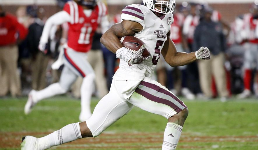 FILE- In this Nov. 26, 2016, file photo, Mississippi State defensive back Cedric Jiles (5) races to a 74-yard interception touchdown run in the second half of an NCAA college football game in Oxford, Miss. The Bulldogs face Miami (Ohio) in the St. Petersburg Bowl. (AP Photo/Rogelio V. Solis, File)