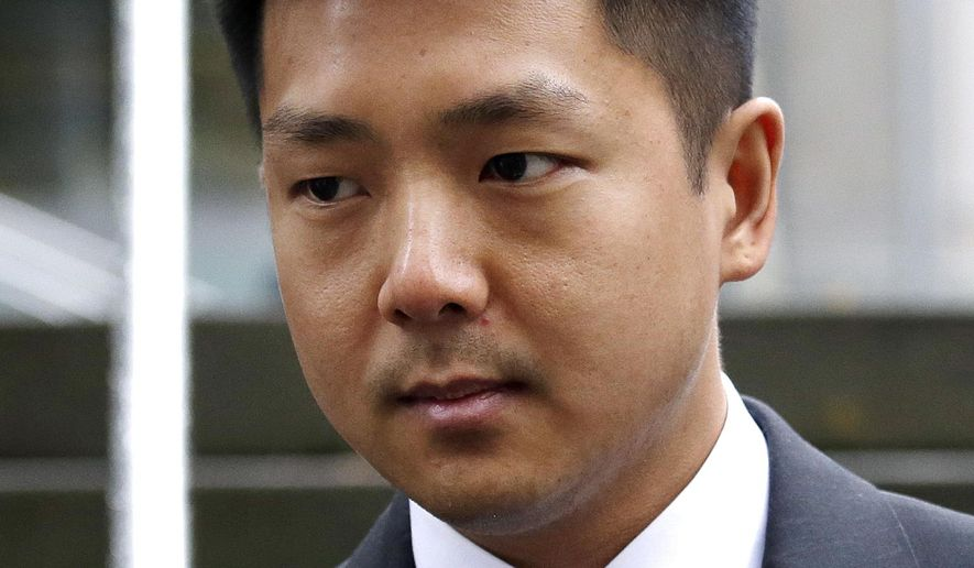 Jonathan Ly, left, leaves U.S. District Court in Seattle after pleading guilty to one count of securities fraud, Monday, Dec. 5, 2016. Ly pleaded guilty to allegations that he used his access to the computers of top executives to rummage through their email, then made lucrative illegal stock trades based on the inside information he discovered. (AP Photo/Elaine Thompson)