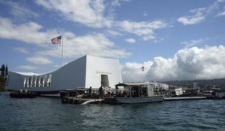In this June 3, 2015, file photo released by the U.S. Navy, sailors work to repair the floating dock next to the USS Arizona Memorial in Pearl Harbor, Hawaii, after the USNS Mercy hospital ship struck the memorial's dock in May as it was leaving Pearl Harbor.  Japan's leader says he will visit Pearl Harbor with U.S. President Barack Obama at the end of this month. Prime Minister Shinzo Abe said Monday, Dec. 5, 2016, he will visit Hawaii in late December and hold a final summit meeting there with Obama before the American leader leaves office. (Laurie Dexter/The U.S. Navy via AP, File)