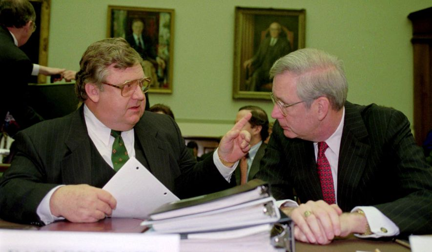 FILE- In this May 21, 1992, file photo, Deputy Secretary of State Lawrence Eagleburger, left, talks with Edward Kelley Jr., a member of the Federal Reserve Board of Governors, prior to a hearing of the House Banking Committee in Washington. Kelley, who served 14 years as a member of the Federal Reserve Board, has died. His death was confirmed Monday, Dec. 5, 2016, by the Fed. He was 84. (AP Photo/John Duricka, File)