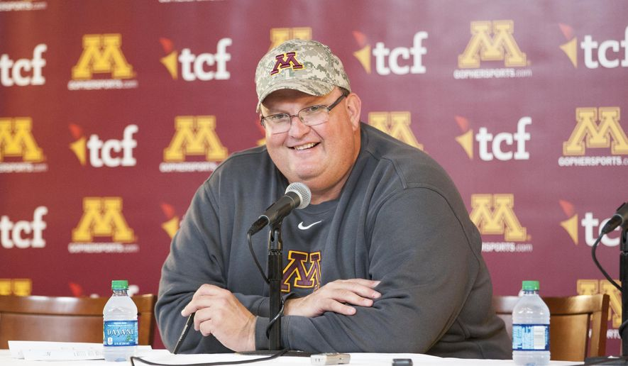 FILE - In this Nov. 5, 2016, file photo, Minnesota head coach Tracy Claeys addresses the media after an NCAA college football game against Purdue,  in Minneapolis. The Gophers have a new sunny bowl venue by the sea to explore in San Diego. They will play in the Holiday Bowl in San Diego against Washington State on Dec. 27. (AP Photo/Paul Battaglia, File)