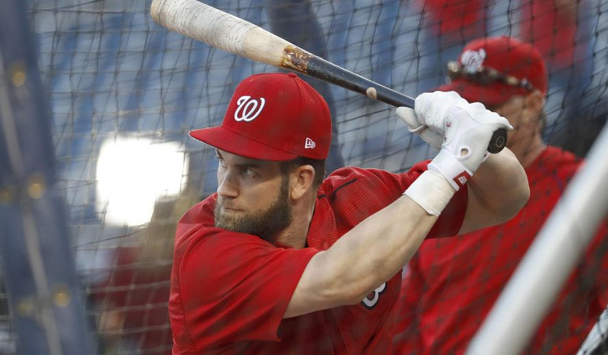FILE - In a Thursday, Oct. 13, 2016 file photo, Washington Nationals right fielder Bryce Harper waits to swing during batting practice before Game 5 of baseball's National League Division Series against the Los Angeles Dodgers at Nationals Park, in Washington. Meeting with reporters Monday, Dec. 5, 2016, at baseball's winter meetings, Washington Nationals general manager Mike Rizzo deflected a question about whether he's engaged Harper or agent Scott Boras about an extension for the slugger, who was the 2012 NL Rookie of the Year and 2015 NL MVP.  (AP Photo/Alex Brandon, File)