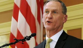FILE - In this Jan. 12, 2016 file photo, South Dakota Gov. Dennis Daugaard delivers his annual state of the state address at the Capitol in Pierre. Daugaard says his upcoming budget proposal won't include cuts, but lower-than-anticipated tax collections will only allow for modest spending increases during the 2017 legislative session. The governor is to outline his spending priorities in a budget address Tuesday, Dec. 6 at the Capitol. (AP Photo/James Nord, File)