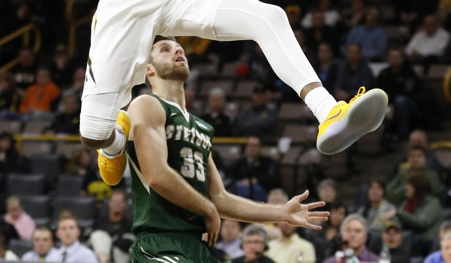 Iowa guard Maishe Dailey drives to the basket over Stetson guard Luke Doyle (33) during the second half of an NCAA college basketball game, Monday, Dec. 5, 2016, in Iowa City, Iowa. Iowa won 95-68. (AP Photo/Charlie Neibergall)