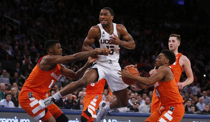 Connecticut's Rodney Purvis (15) has the ball stolen by Syracuse's John Gillon (4) as Syracuse's Franklin Howard (1) defends during the first half of an NCAA college basketball game Monday, Dec. 5, 2016, in New York. (AP Photo/Jason DeCrow)