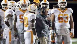 FILE -- In this Nov. 26, 2016, file photo, Tennessee head coach Butch Jones talks with his players during a 45-34 loss to Vanderbilt in an NCAA college football game in Nashville, Tenn. Tennessee will be making a return trip to Nashville Dec. 30 for a Music City Bowl matchup with Nebraska. The game might be a way for the program to regain momentum after a late slide that included defensive collapses and stunning losses at South Carolina and Vanderbilt. (AP Photo/Mark Humphrey, File)