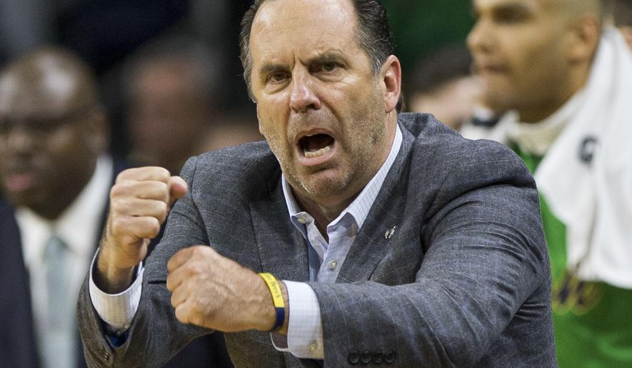 FILE - In this Nov. 29, 2016, file photo, Notre Dame head coach Mike Brey yells to his players during the second half of an NCAA college basketball game against Iowa, in South Bend, Ind. Not many expected Notre Dame to be the last unbeaten team in the Atlantic Coast Conference or to match its best start in 17 seasons under Mike Brey after losing its top two scorers from last season. (AP Photo/Robert Franklin, File)