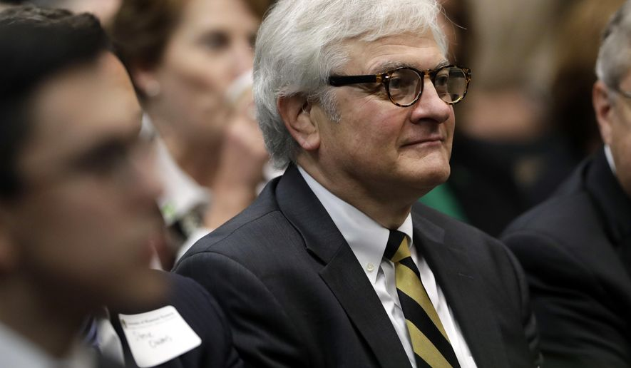 FILE - In this Nov. 2, 2016 file photo, University of Missouri interim chancellor Hank Foley sits in the audience during an event naming Mun Y. Choi as the new president of the University of Missouri system in Jefferson City, Mo. The university said the search firm that helped the system find Choi also will lead the search for a permanent chancellor for the Columbia campus in a statement Monday, Dec. 5, 2016. Foley, interim chancellor since November 2015, also issued a statement Monday saying he would like to be permanent chancellor. (AP Photo/Jeff Roberson File)