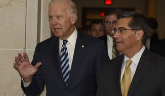 Vice President Joe Biden, accompanied by House Democratic Caucus Chairman Rep. Xavier Becerra, D-Calif., arrives on Capitol Hill in Washington, Tuesday, Dec. 6, 2016, to address the House Democratic Caucus. (AP Photo/Sait Serkan Gurbuz)