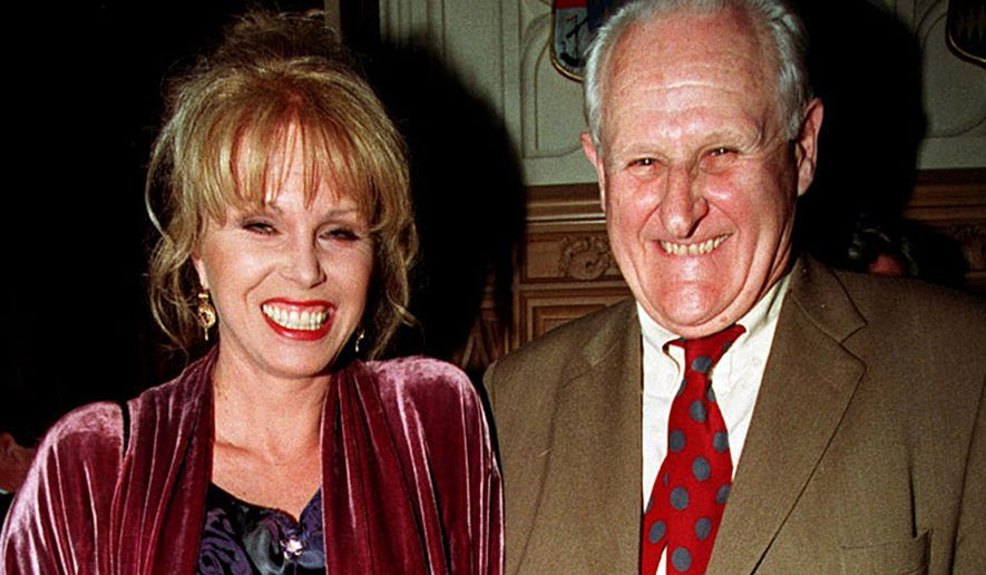 "In this April 29, 1998, file photo, actress  Joanna Lumley, left and actor Peter Vaughan, pose for a photo, in London. Veteran British character actor Peter Vaughan, who played the enigmatic Maester Aemon in ""Game of Thrones,"" has died aged 93. Vaughan's agent Sally Long-Innes says he died Tuesday, Dec. 6, 2016 surrounded by his family. (Fiona Hanson/PA via AP, File) **FILE**"