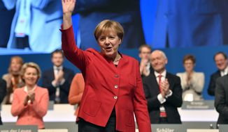 German Chancellor and Chairwomen of the CDU, Angela Merkel, waves after her speech as part of a general party conference of the Christian Democratic Union (CDU) in Essen, Germany, Tuesday, Dec. 6, 2016. Merkel wants to secure the backing of her conservative party to head up the party's campaign for next September's election. (AP Photo/Martin Meissner)