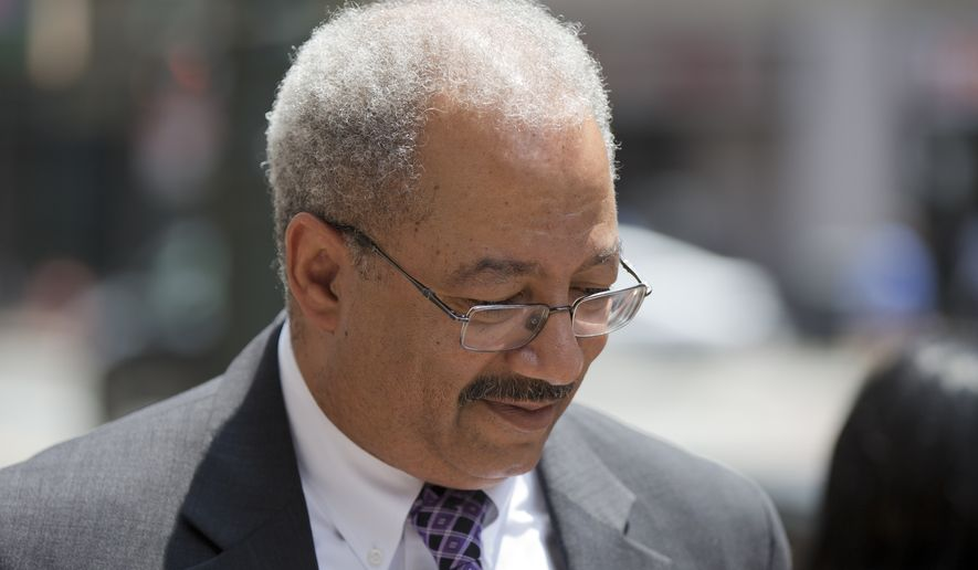 FILE- In this June 21, 2016, file photo, Rep. Chaka Fattah, D-Pa., walks after leaving the federal courthouse in Philadelphia. Federal prosecutors are seeking a sentence of 17 to 21 years for the former Pennsylvania congressman convicted of a racketeering scheme that included a string of illicit financial moves to cover up an illegal $1 million campaign loan. (AP Photo/Matt Rourke, File)