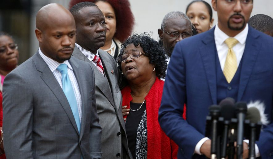 FILE - In this Monday, Dec. 5, 2016, file photo, Judy Scott, center, Walter Scott's mother, is comforted by her son Rodney Scott, as the family attorneys, Chris Stewart, left, and Justin Bamberg, right, hold a press conference after a mistrial was declared in the Michael Slager trial Monday Dec. 5, 2016, in Charleston, S.C. Relatives of Walter Scott, the black motorist fatally shot while fleeing a traffic stop, say they are confident justice will prevail even though a South Carolina jury could not reach a verdict in the murder trial of a white former police officer charged in his death. (AP Photo/Mic Smith, File)